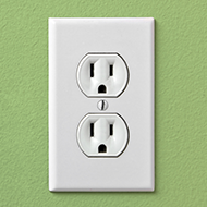 Outlet on a Green Wall